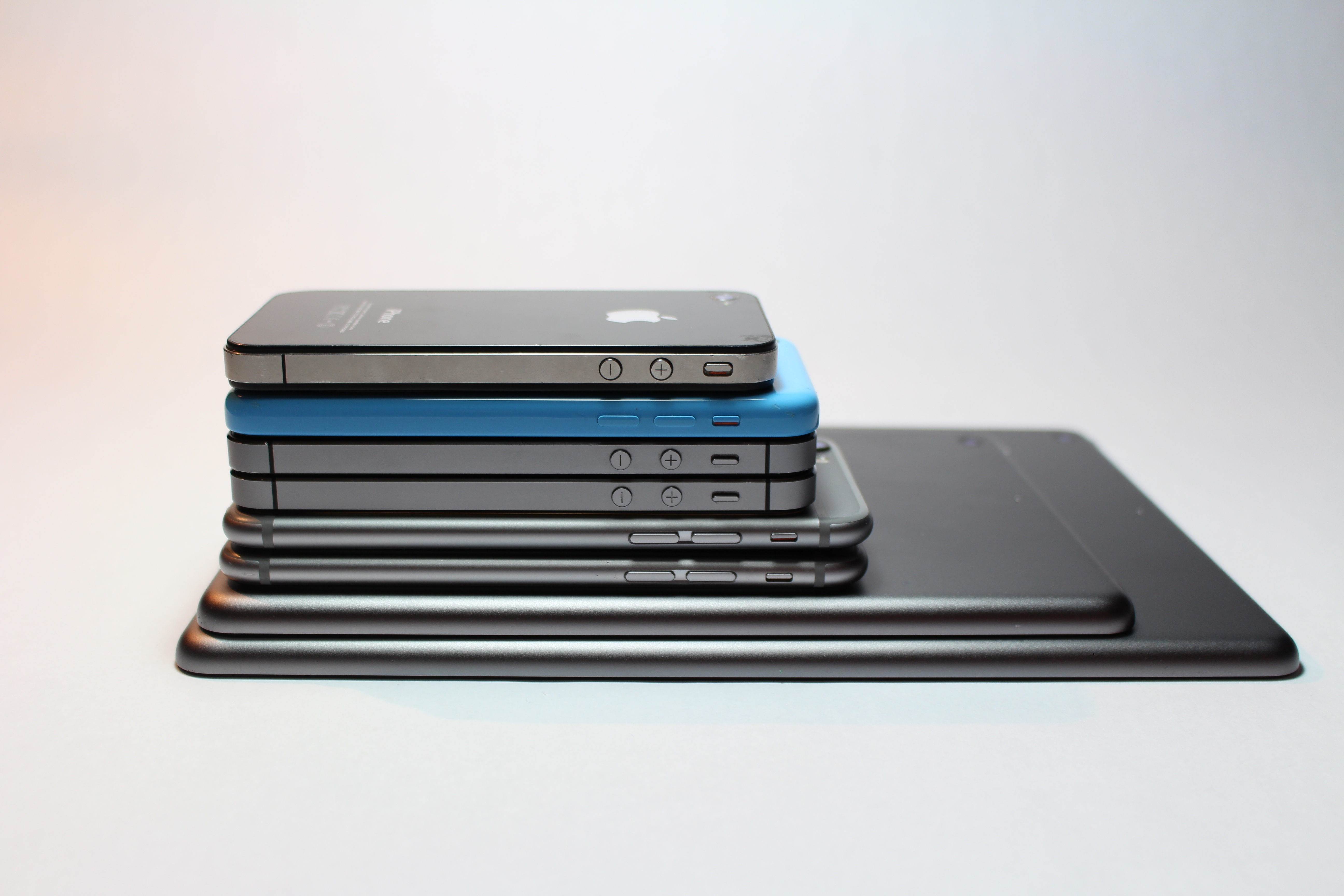 Various Smartphones stacked on top of each other