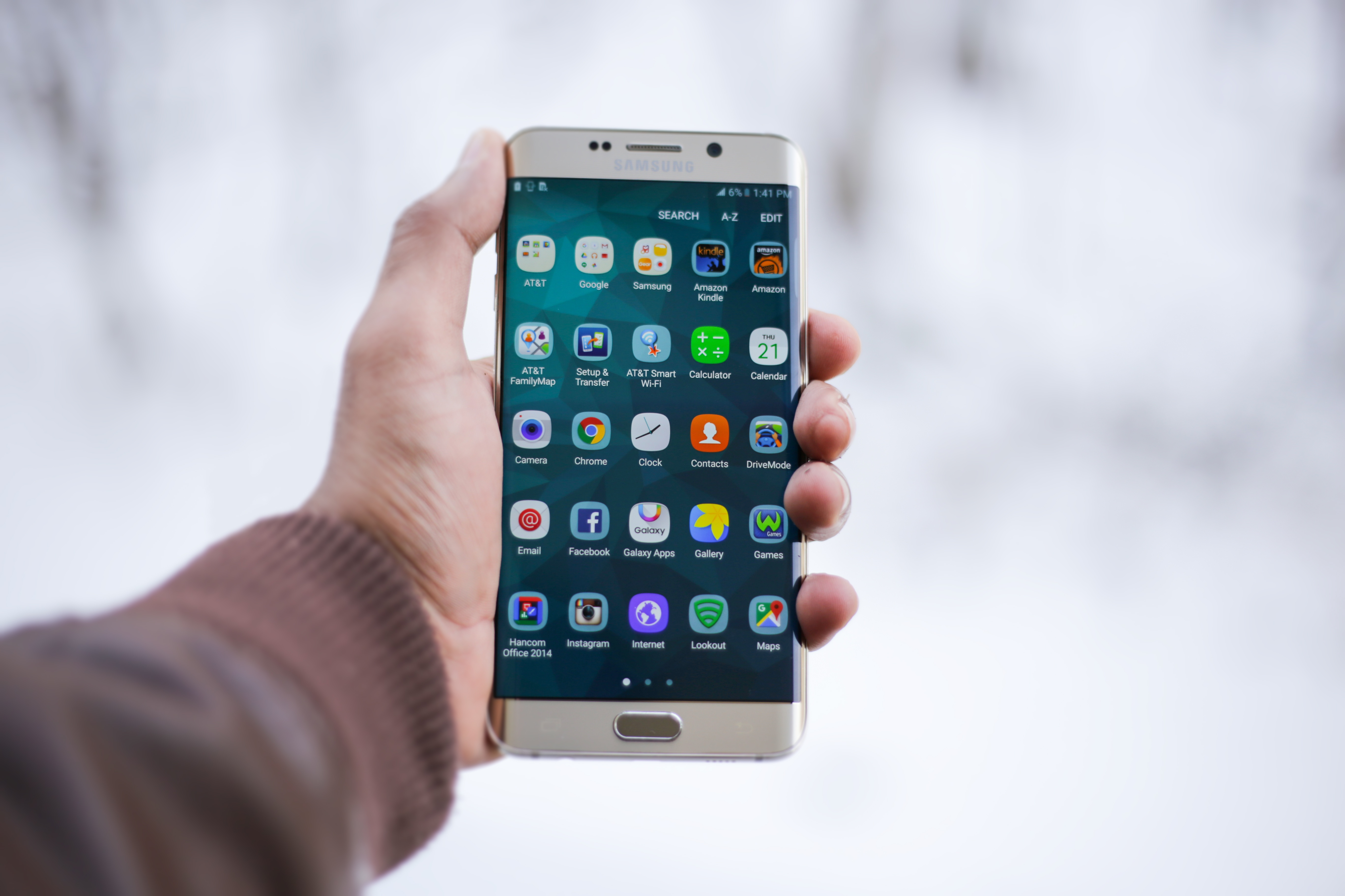A person holding up a smartphone